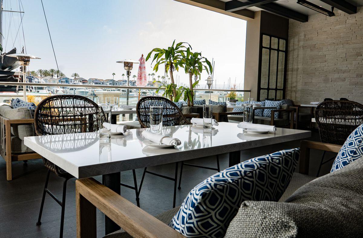 Patio tables on the bay at Shorebird in Newport Beach.