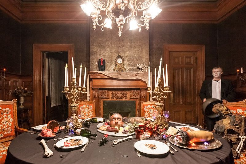 The dining room in a Victorian home, with the table covered in faux limbs and blood.