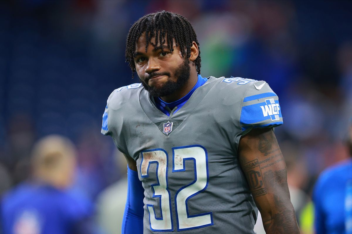 D'Andre Swift #32 of the Detroit Lions walks off field after a loss to the Baltimore Ravens at Ford Field on September 26, 2021 in Detroit, Michigan.