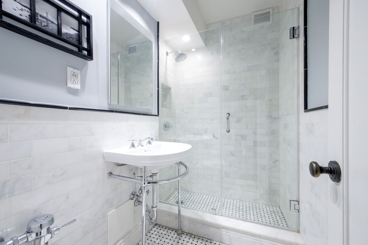 A bathroom with black and white floor tiles.