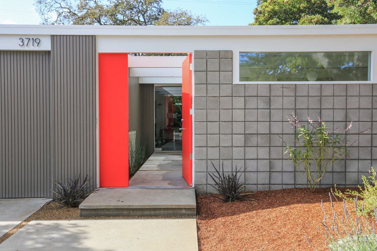 Exterior shot of Eichler in Palo Alto with red good and grey facade.