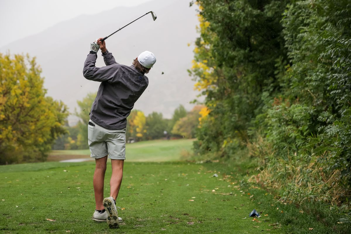 Spanish Fork's Jackson Rhees hits a tee shot at the 5A boys state golf tournament at The Oaks at Spanish Fork.