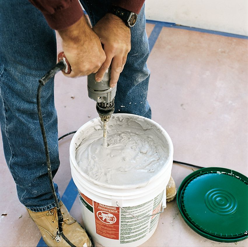 Man Stirs Compound To Prepare For Drywall