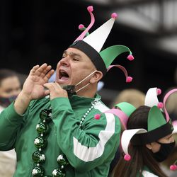 A fan pulls down his mask to cheer as Hillcrest competes in the show category of the 5A state drill team finals at the UCCU Center in Orem on Thursday, Feb. 4, 2021. Other categories are military and dance.
