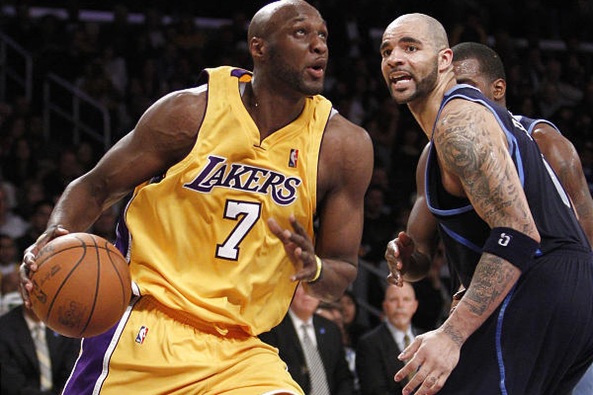 L.A. Lakers' Lamar Odom, left, drives to the basket around Utah Jazz forward Carlos Boozer, right, during the Lakers' 106-92 win Friday.