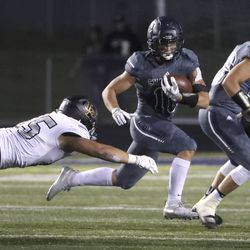 Action in the Lone Peak at Corner Canyon football game in Draper on Friday, Sept. 27, 2019.