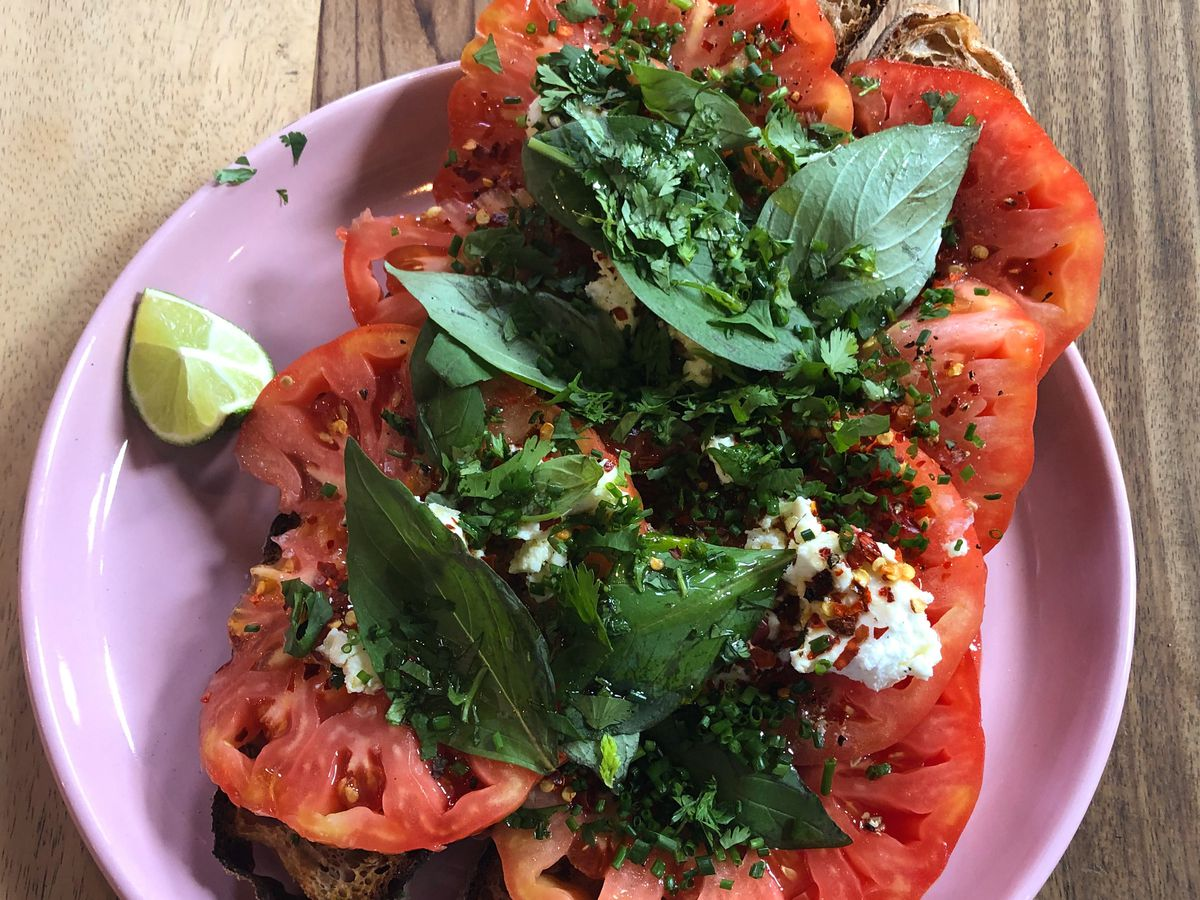 Tomato and goat's feta toast at Carthage Must Be Destroyed