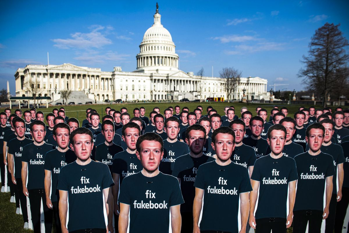 One hundred cardboard cutouts of Facebook founder and CEO Mark Zuckerberg stand outside the US Capitol during Zuckerberg's testimony in  front of Congress, on April 10, 2018.