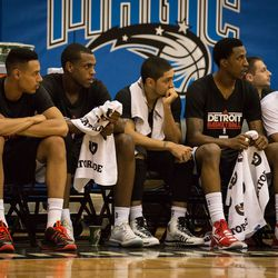 Detroit's young backcourt watches from the bench.