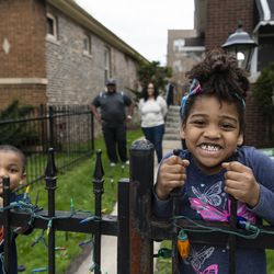 Nathasha Norwood hangs hangs on a fence with her brother John-Michael, Tuesday, April 28, 2020.