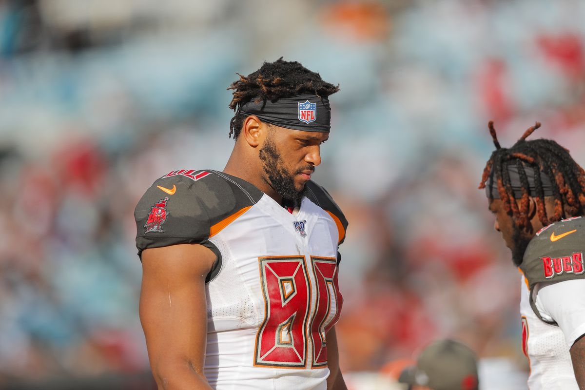 O.J. Howard of the Tampa Bay Buccaneers looks on from the sideline during the third quarter of a game against the Jacksonville Jaguars at TIAA Bank Field on December 01, 2019 in Jacksonville, Florida.