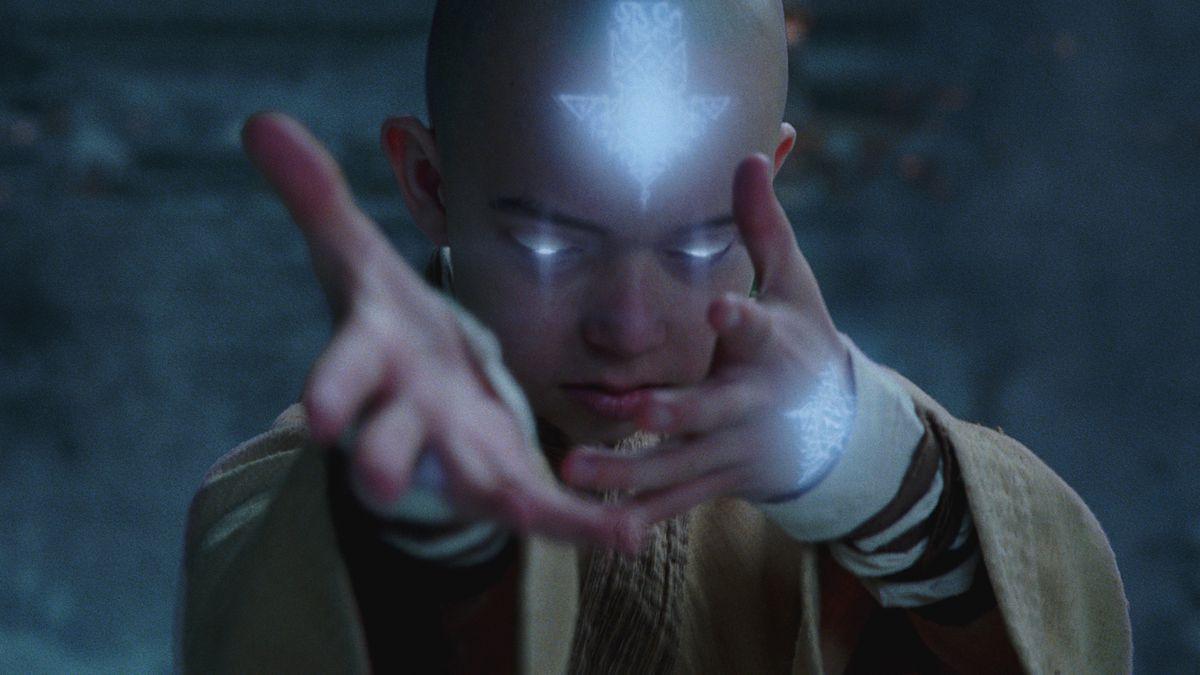 a bald boy's eyes turn bright blue