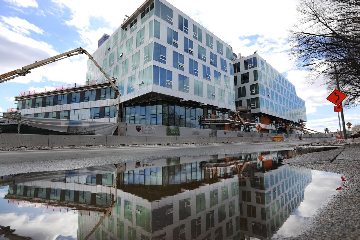 A glassy, multistory engineering and applied sciences school under construction.