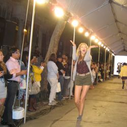 An overly animated model at the ASOS and Teen Vogue block party runway show