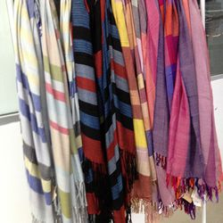 Hand-made Ketzali scarves were $40 to $57, while a shawl will run you $100.