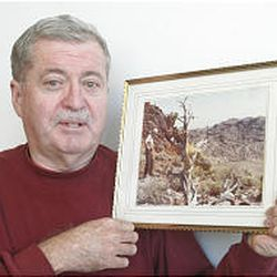 Douglas Cannon shows a picture of his father, Floyd Cannon, looking for minerals north of the Bertha Mine near Dugway Proving Ground in western Tooele County.