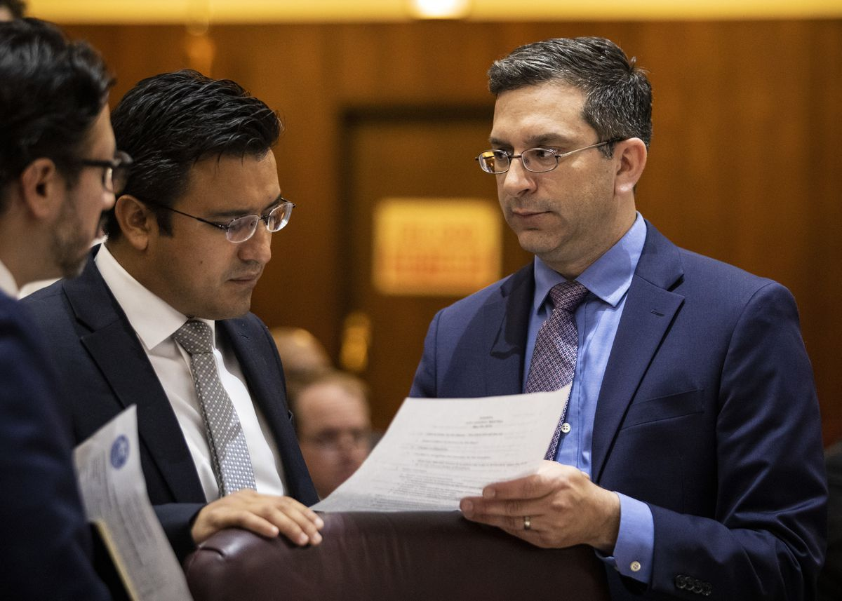 Ald. Scott Waguespack (32nd) chats with Ald. Byron Sigcho-Lopez (25th) and a staffer before the start of Wednesday's Chicago City Council meeting at City Hall.
