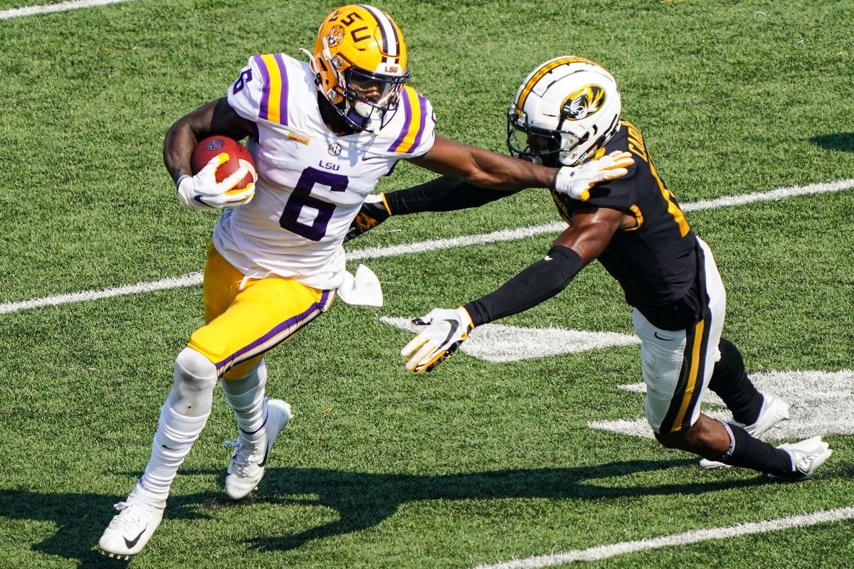 LSU Tigers wide receiver Terrace Marshall Jr. (6) runs against Missouri Tigers defensive back Jaylon Carlies (17) during the second half at Faurot Field at Memorial Stadium.