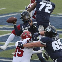 Utah State Aggies quarterback Jason Shelley (15) throws against the Fresno State Bulldogs in Logan on Saturday, Nov. 14, 2020.