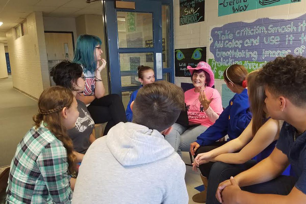 Lisa Lee, center right, one of two gifted and talented teachers at Wheat Ridge High School, leads a discussion. Lee was a teacher of the year finalist.