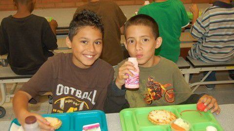 Students at Aurora's Park Lane Elementary eat lunch.