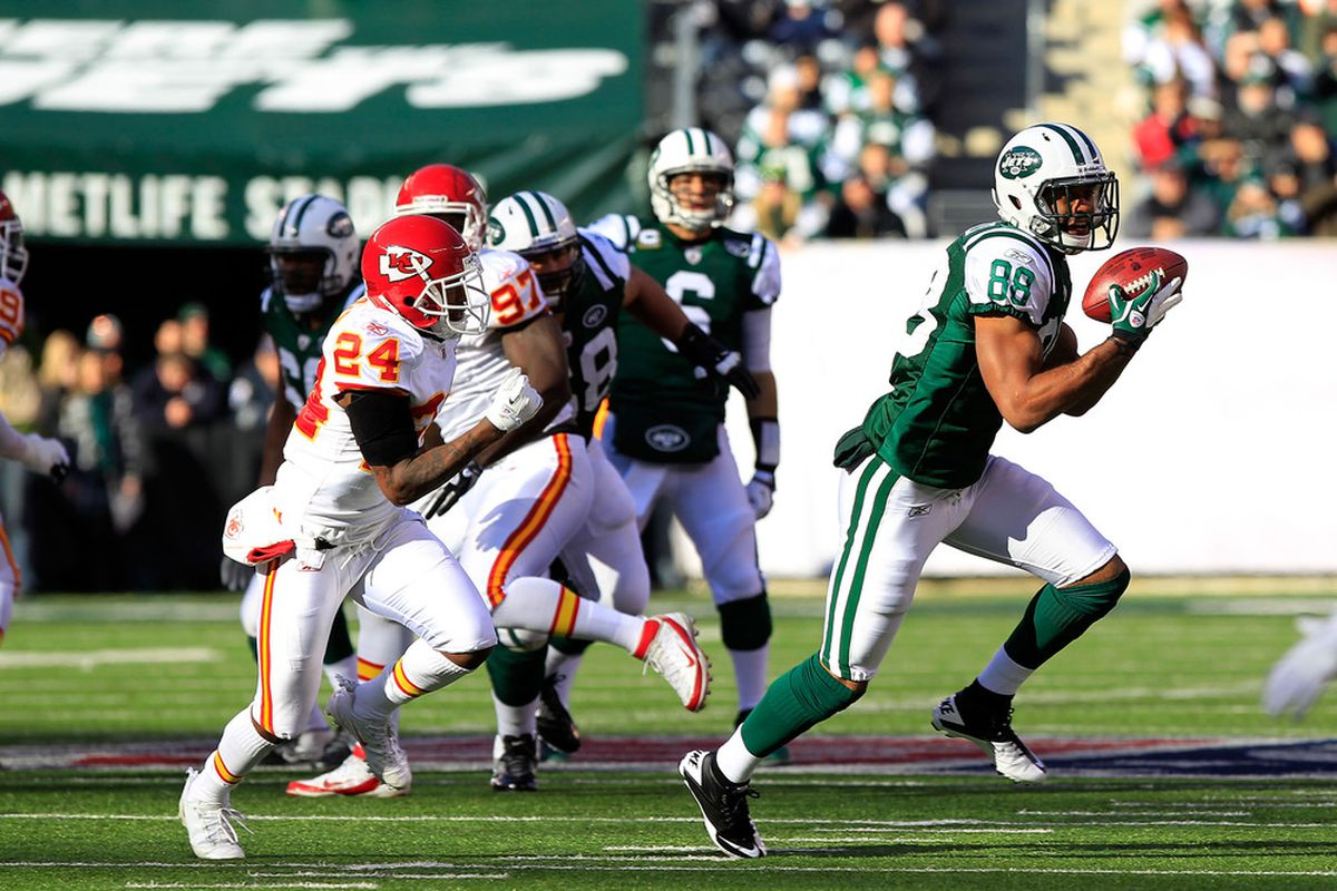 EAST RUTHERFORD, NJ - DECEMBER 11:  Patrick Turner #88 of the New York Jets runs from  Brandon Flowers #24 of the Kansas City Chiefs  at MetLife Stadium on December 11, 2011 in East Rutherford, New Jersey.  (Photo by Chris Trotman/Getty Images)