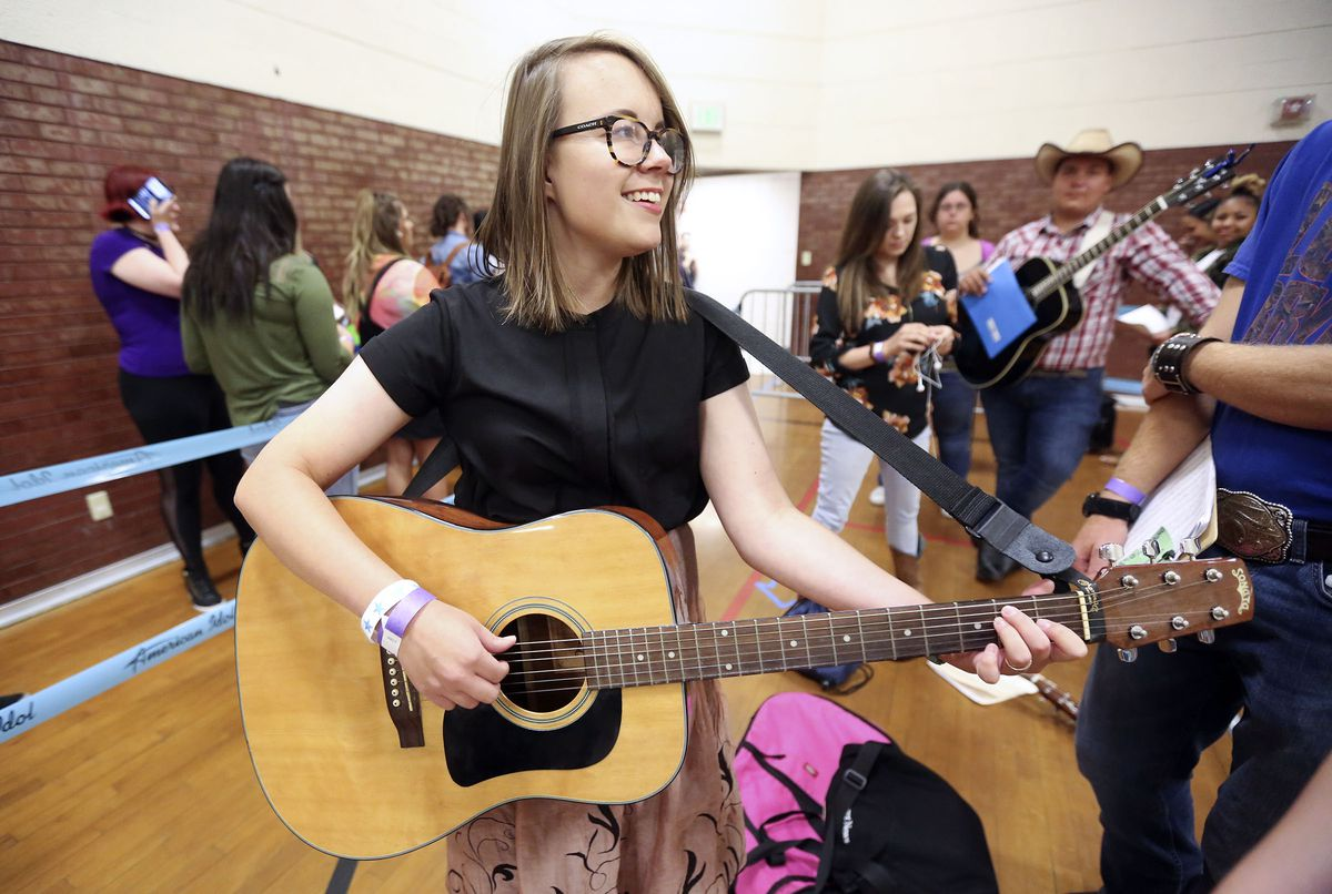 """Lottie Johnson, Deseret News arts and entertainment assistant editor, plays guitar and sings while waiting for """"American Idol"""" auditions at the Northwest Community Center in Salt Lake City on Thursday, Aug. 29, 2019."""