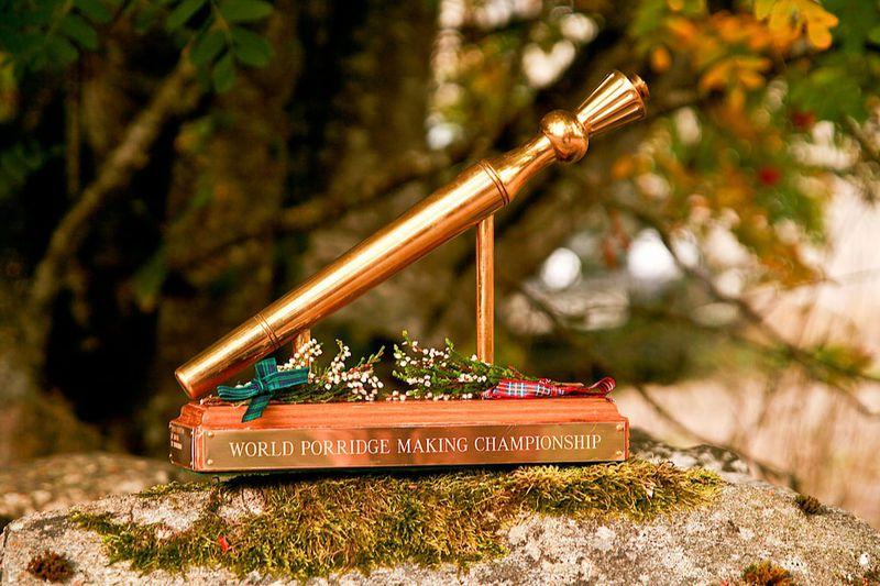 "A gold trophy reads ""World Porridge Making Championship"""
