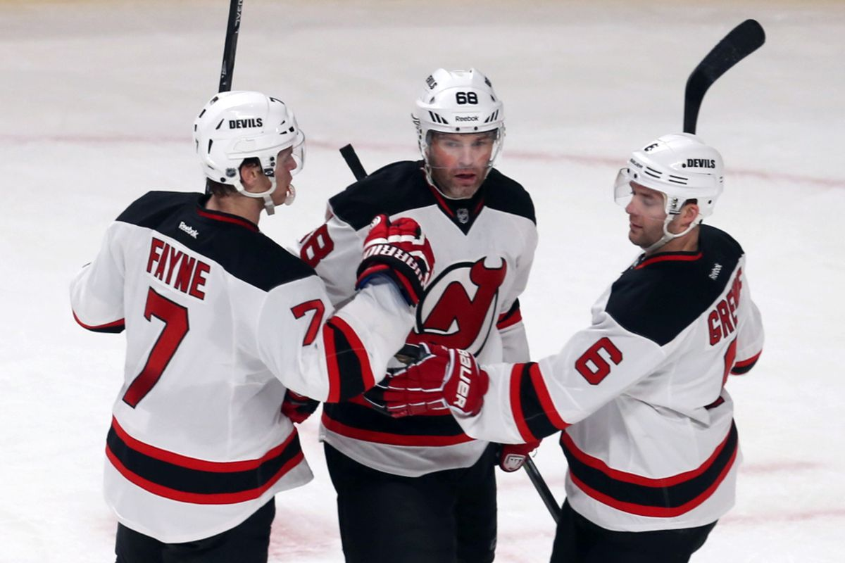 Pictured: Jaromir Jagr (center) celebrating a goal with the two best defensemen on the ice tonight (Fayne, left; Greene, right)