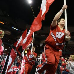 The Badger Cheer Squad leads the team out of the tunnel