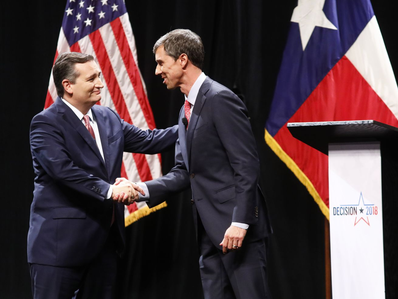 Ted Cruz and Beto O'Rourke shake hands after a debate for Texas's US Senate seat in September 2018.