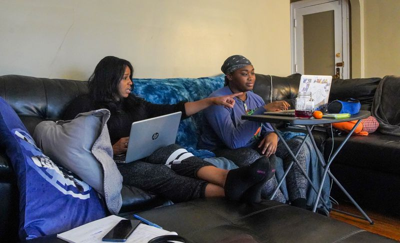 Kim Tyler worked along side her daughter, Madison who was taking an e-learning class from the comfort of their home on Chicago's south side on Wednesday, April 8, 2020.