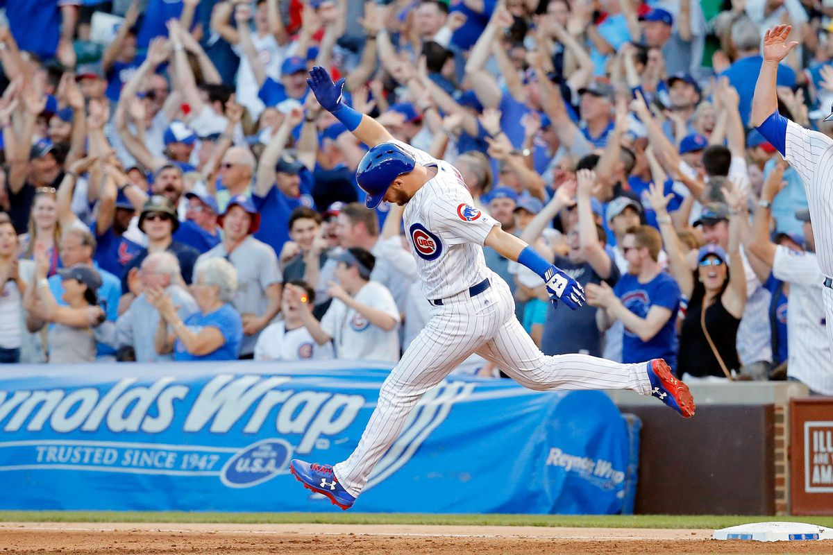 CHICAGO, IL - JUNE 04: Ian Happ #8 of the Chicago Cubs celebrates as he rounds the bases after hitting a three run home run against the St. Louis Cardinals during the fourth inning at Wrigley Field on June 4, 2017 in Chicago, Illinois.  (Photo by Jon Durr/Getty Images)