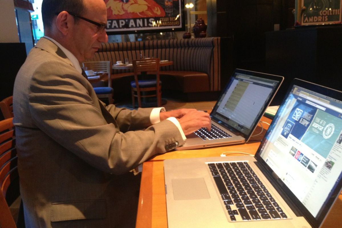 It is clear that MLS Commish Don Garber not only is a multi-tasking machine but he is clearly an Apple guy.
