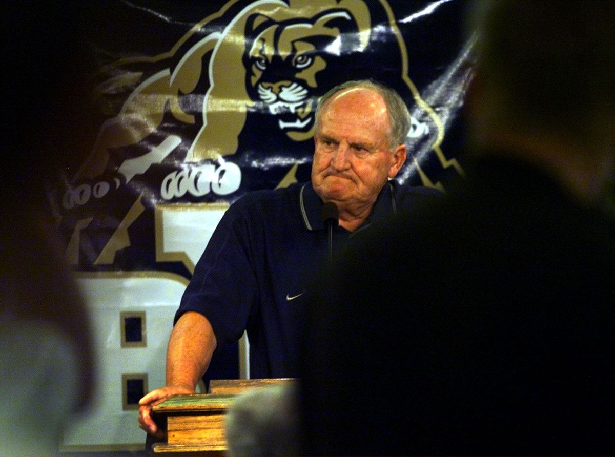 BYU football coach LaVell Edwards announces his retirement at a press conference at Cougar Stadium in Provo in 2000.
