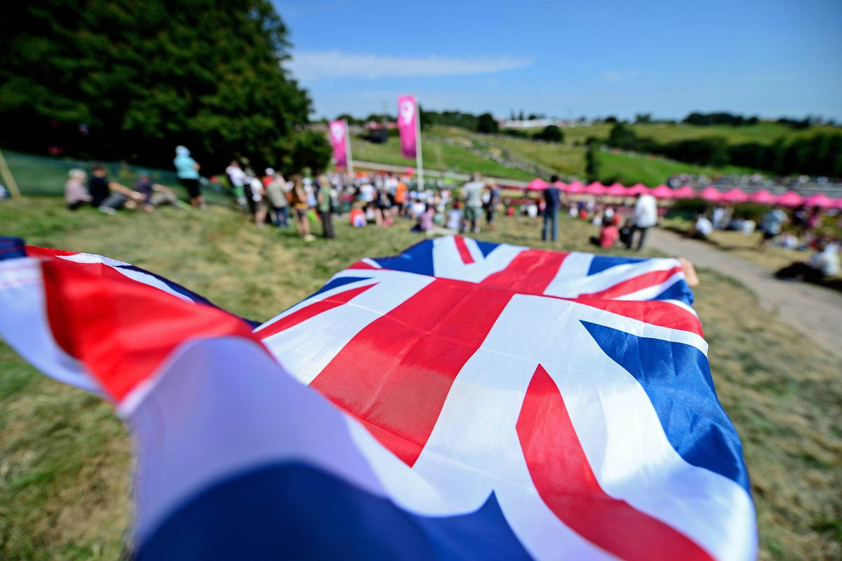 Aug 12, 2012; Essex, United Kingdom; Great Britain fans fly a British flag during the men's mountain bike cross country final during the London 2012 Olympic Games at Hadleigh Farm. Mandatory Credit: Andrew Weber-USA TODAY Sports
