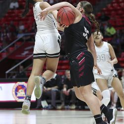 Highland's Lei Makaui (2) has her shot blocked by Mountain View's Nicole Riley (55) during a 5A girls semifinal game at the Jon M. Huntsman Center in Salt Lake City on Thursday, Feb. 27, 2020. Highland won 54-45.