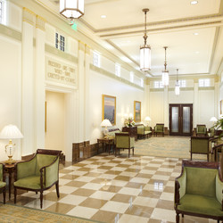 View of the grand foyer of the Mesa Arizona Temple. More than 50 decorative paints from the original 1920s color palette were used to bring this room back to its original luster. Checkerboard marble flooring from Turkey and Spain and marble wainscot and base from the original quarry in Birdseye, Utah, are some of the other materials used.