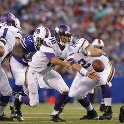 Aug 16, 2013; Orchard Park, NY, USA; Minnesota Vikings quarterback Matt Cassel (16) pitches out the ball against the Buffalo Bills during the second quarter at Ralph Wilson Stadium. at Ralph Wilson Stadium.