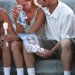 Casey Lodmell and Adam Bishop comforted each other last year at candlelight vigil in Idaho for daughter Acacia.