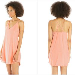 """""""I've been wooed recently by LA's <b>Rory Beca</b>, which does silk dresses with <i>just</i> the right amount of sexy, without giving away the cow (<a href=""""http://rorybeca.com/dresses/liyah-multi-strap-dress-3471?color=powderpuff"""">pictured</a>, $218). I"""