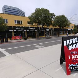A sign for City Barbers is on display on Broadway between 200 East and 300 East in Salt Lake City on Thursday, June 18, 2020.
