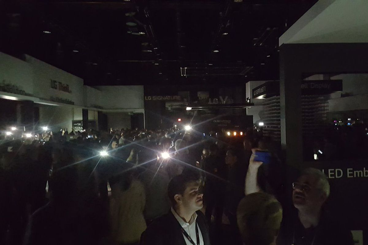 Conference-goers at CES used flashlights to find their way through the convention center when the power went out.