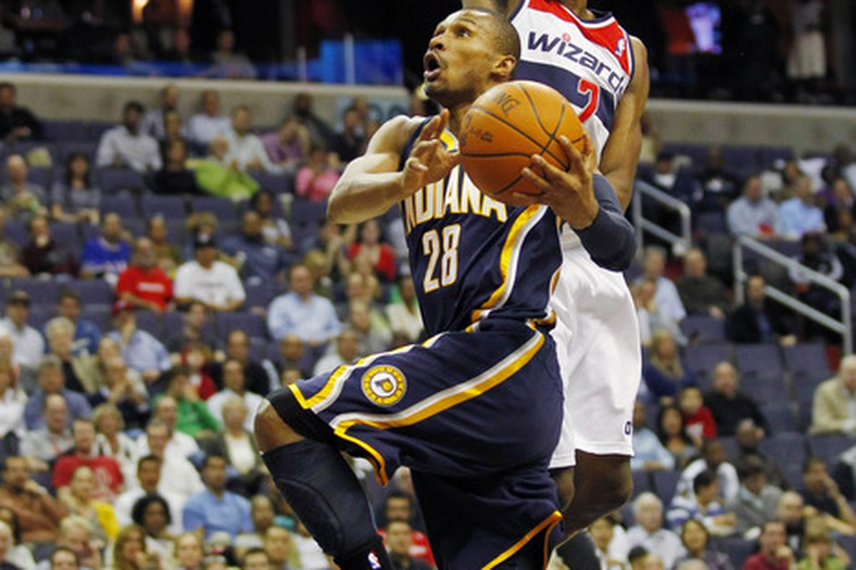 April 4, 2012; Washington, DC, USA; Indiana Pacers shooting guard Leandro Barbosa (28) shoots the ball as Washington Wizards point guard John Wall (2) defends in the first half at Verizon Center. Mandatory Credit: Geoff Burke-US PRESSWIRE