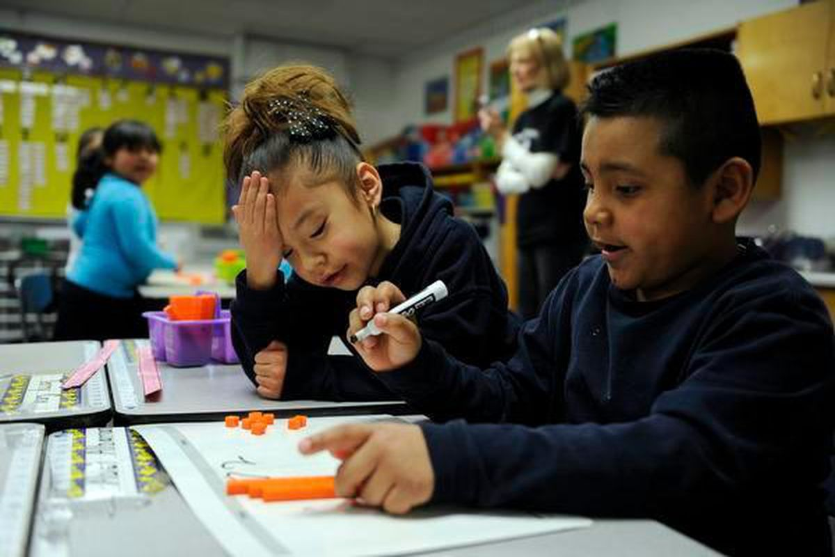 Aris Mocada-Orjas, left, and Abel Albarran work on a math problem at Hanson Elementary in Commerce City. (Denver Post file photo)