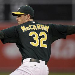 Oakland Athletics' Brandon McCarthy works against the Boston Red Sox in the first inning of a baseball game Friday, Aug. 31, 2012, in Oakland, Calif.