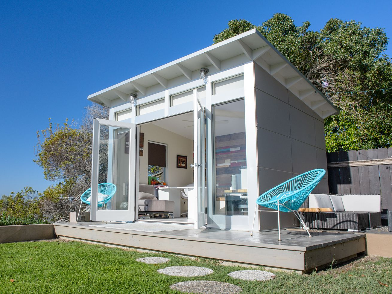 A 10-foot by 12-foot Studio Shed Signature Series model makes a roomy backyard home office.