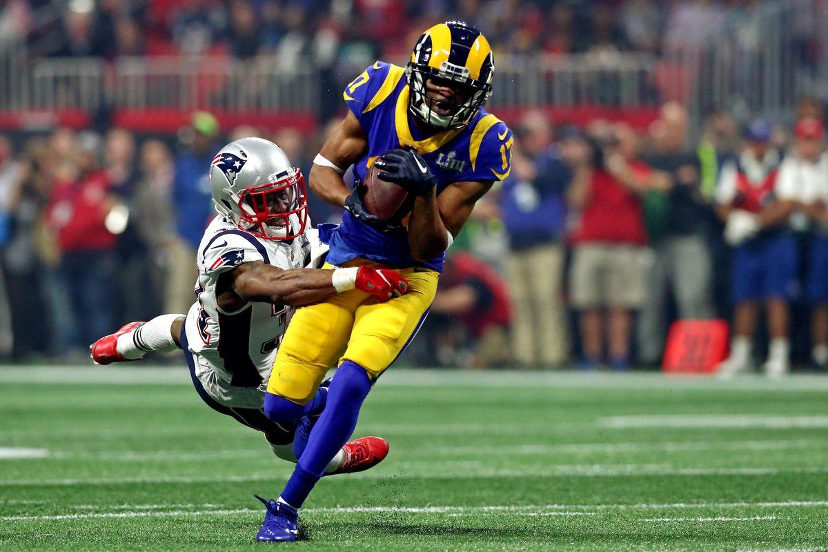 Los Angeles Rams wide receiver Robert Woods runs the ball New England Patriots defensive back Jonathan Jones during the third quarter in Super Bowl LIII at Mercedes-Benz Stadium.
