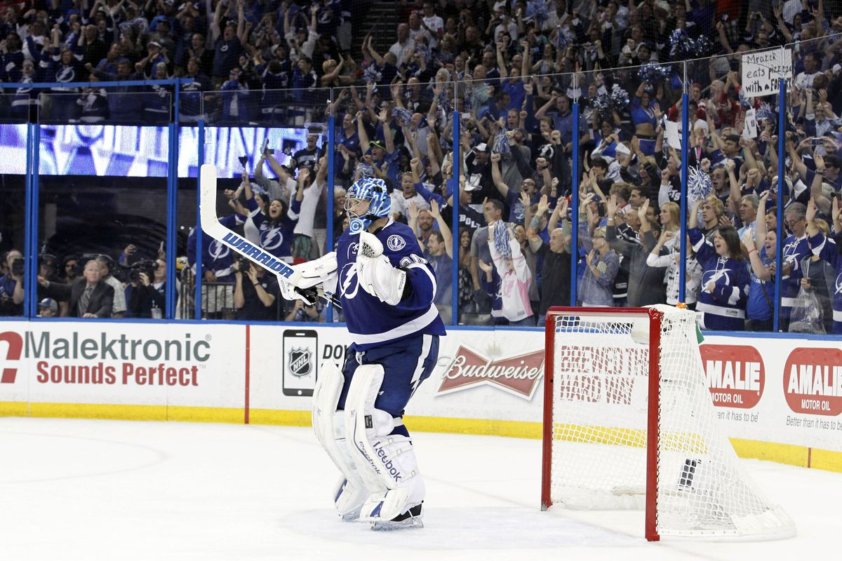 Lightning goalie Ben Bishop and Tampa Bay fans begin to celebrate as the clock winds down in Tampa Bay's series clinching 2-0 win over the Detroit Red Wings Wednesday night