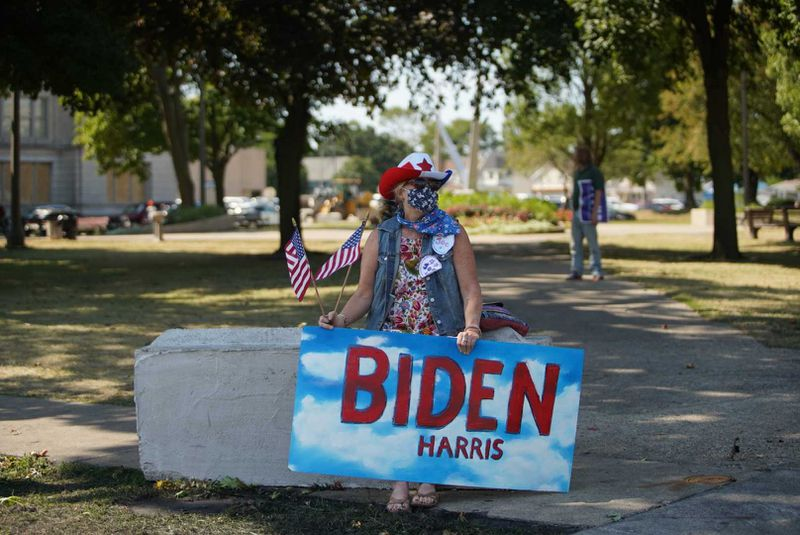 Michelle Stauder, 60, of Kenosha, awaits Joe Biden's arrival Thursday.